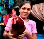 Girls with chicken in Mumbai slum