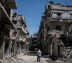 Man walks through Homs in Syria