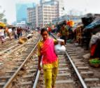 Poverty research - woman on railway track
